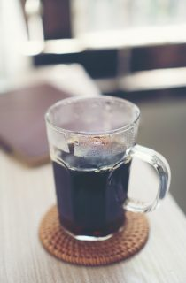 black hot coffee on table in the cafe